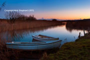 Moored boats after sunset