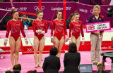 010 Team GB line up for Uneven Bars, L to R Whelan, Pinches, Tweddle & Tunney