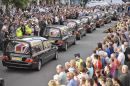Seven Union flag covered hearses on the High Street of Wootton Bassett