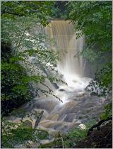 Alva Glen lower waterfall in flood