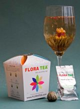 Flora tea with flowering bulb in glass