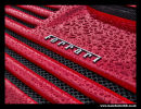 Red Ferrari logo on a rear grille